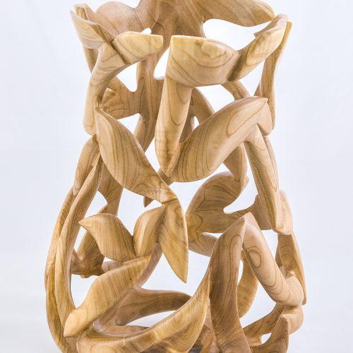 <p>Magnolia Vase<br /> Turned, carved<br /> 9″ x 9″ x 13″</p>